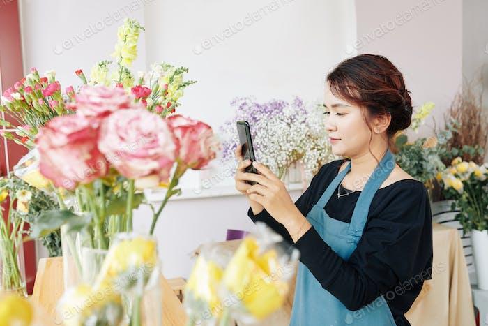 Florist posting photos of bouquets