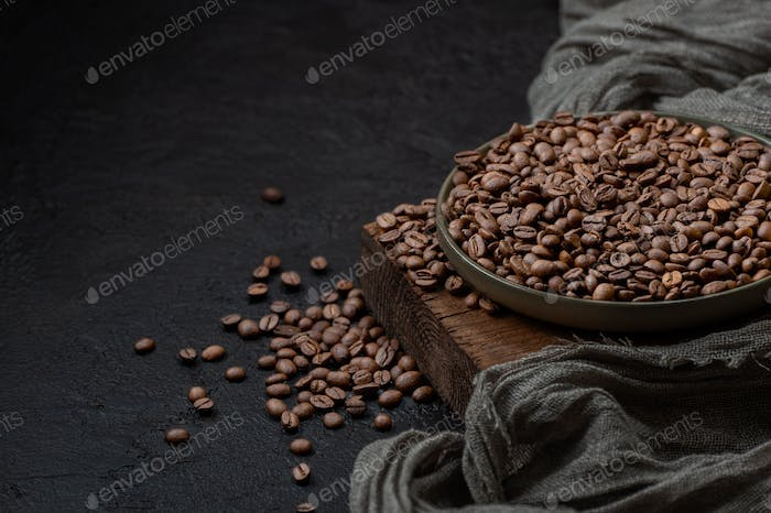 Roasted coffee beans on a dark background. Photo with negative s