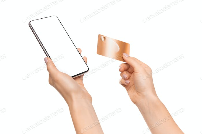 Credit card and smartphone with blank screen in female hands