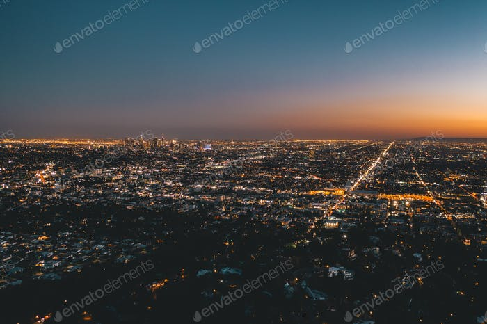Aerial Wide View over Glowing Los Angeles, California City Lights Scape