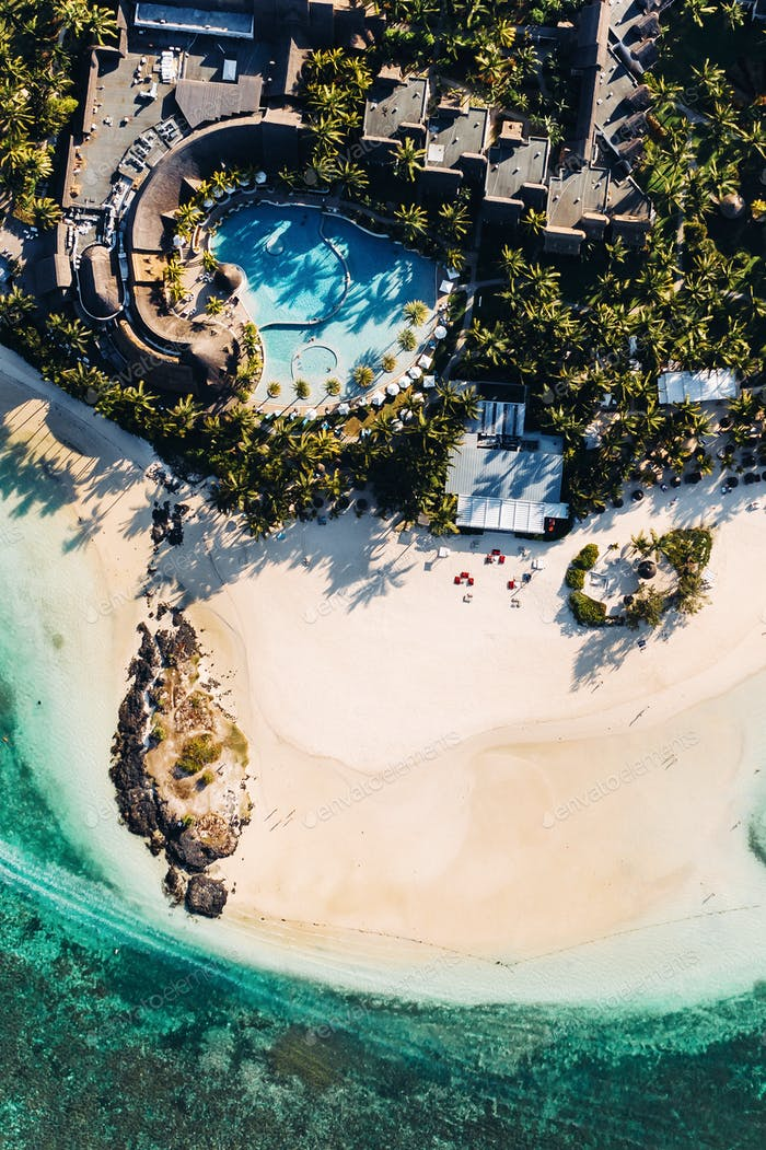 Aerial picture of the east coast of Mauritius Island. Flying above the turquoise lagoon of Mauritius