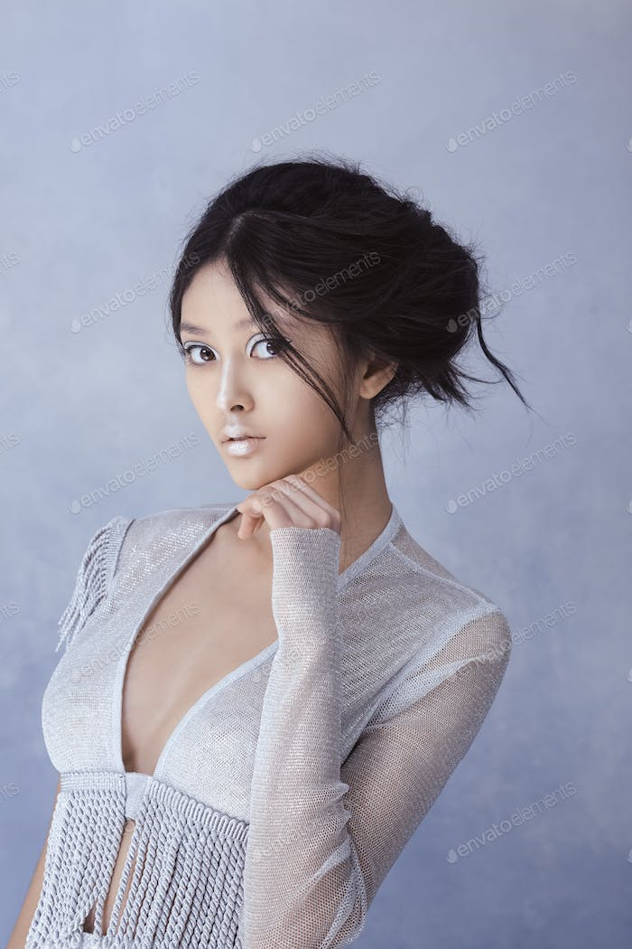 Futuristic sexy young asian woman