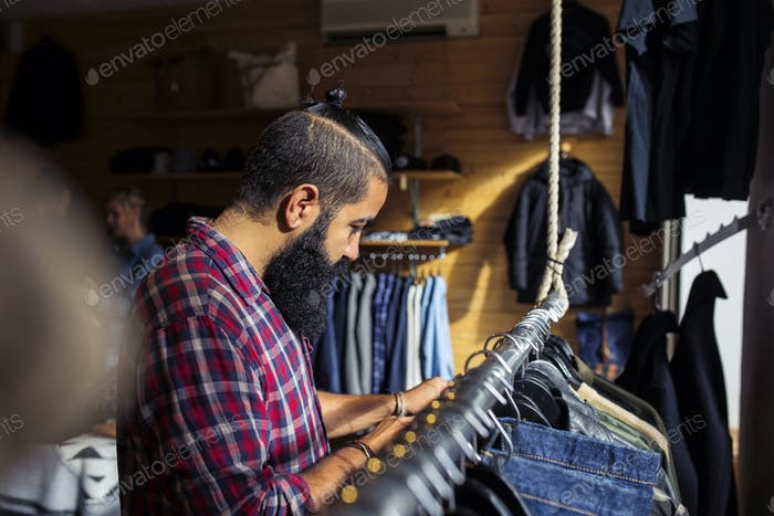 Man choosing clothes in store