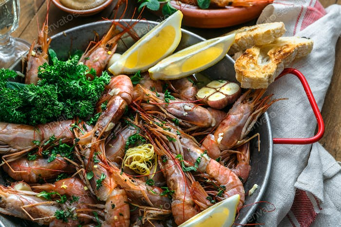 Close view of tiger prawn shrimps roasted with lemon garlic and wine