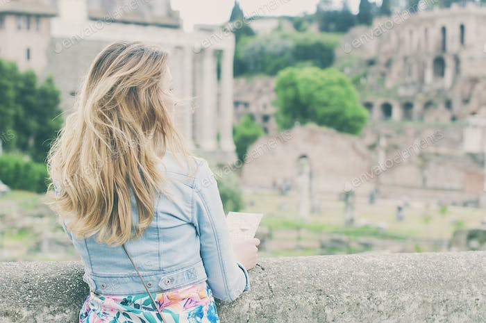 Pretty female tourist on the ruins of the Roman Forum in Rome, Italy