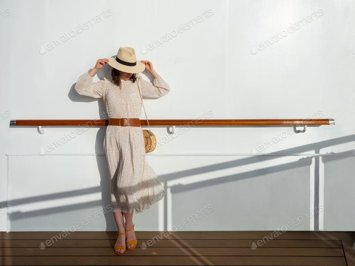 Young woman in a dress on the ship