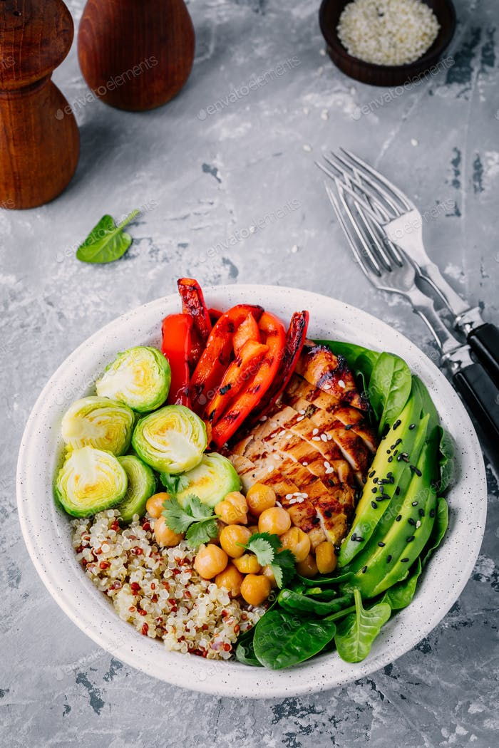 Vegetable bowl with grilled chicken and quinoa, spinach, avocado, brussels sprouts, chickpea