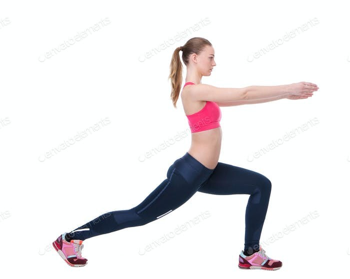 Young woman stretching leg muscles