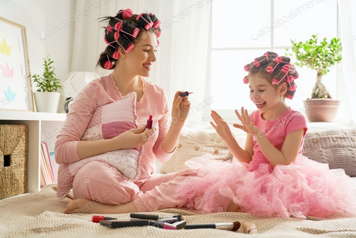 Mother and daughter are doing manicures