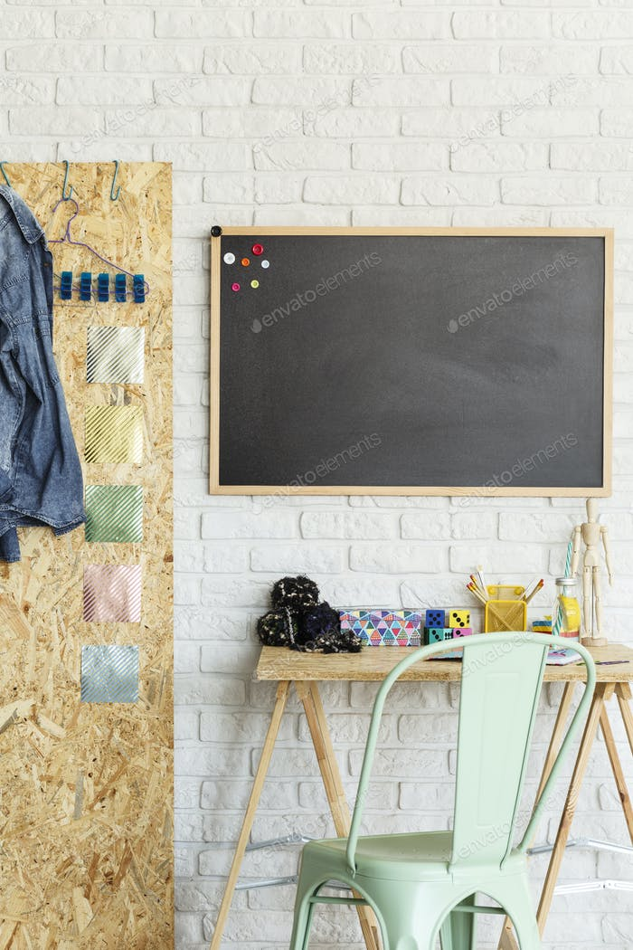 Interior with blackboard and desk