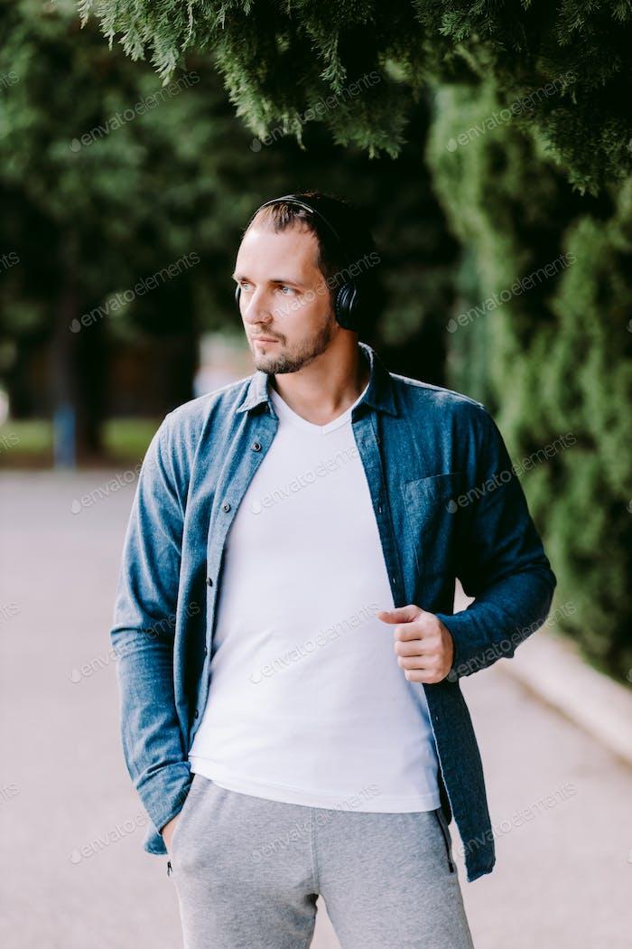 Placeit man wearing white t-shirt mockup outdoors