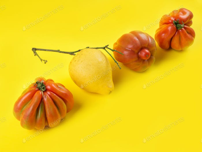 Ugly fruit and vegetables on yellow background