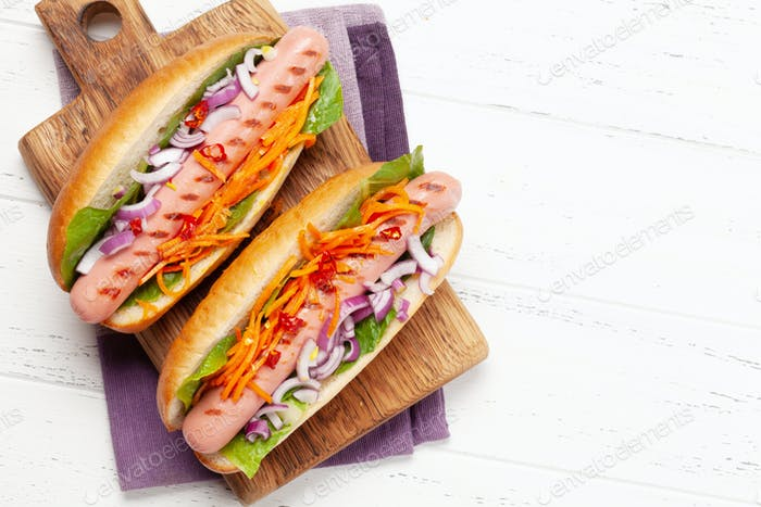 Hot dog with vegetables, lettuce and condiments