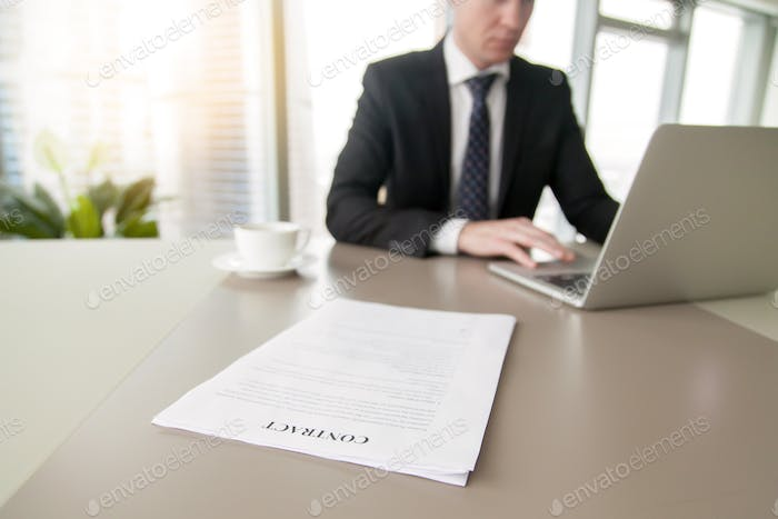 Close up of a contract on the office desk