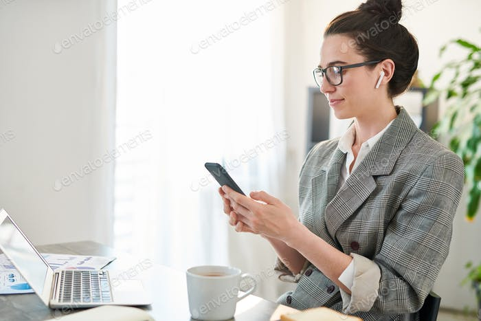 Contemporary Businesswoman Using Tech