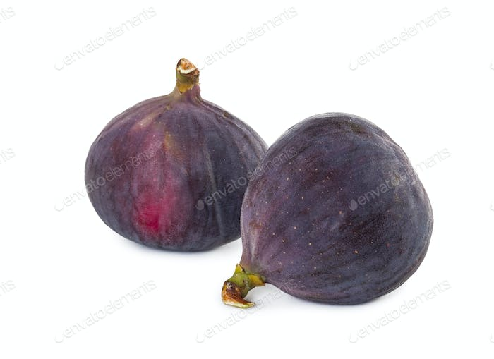 Two fresh figs isolated on white background.