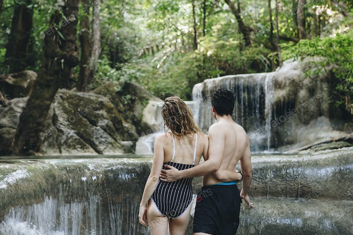 White couple enjoying the waterfall