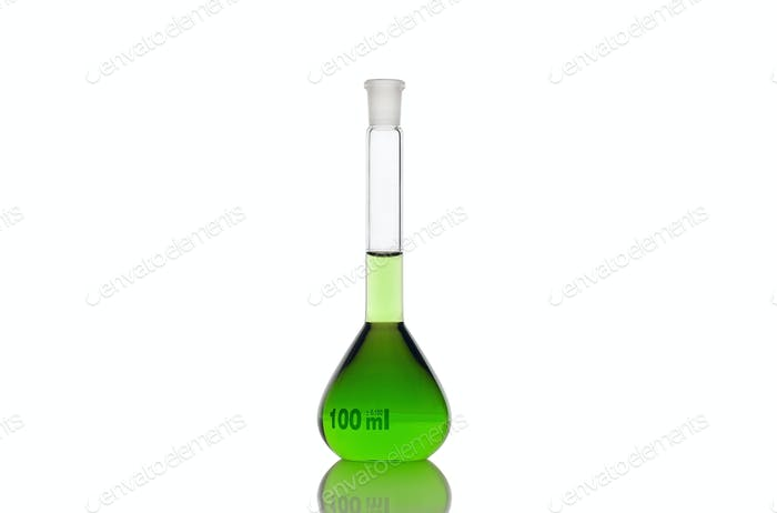Volumetric flask with green liquid on white background