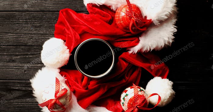 Cup of coffee with Christmas hats around