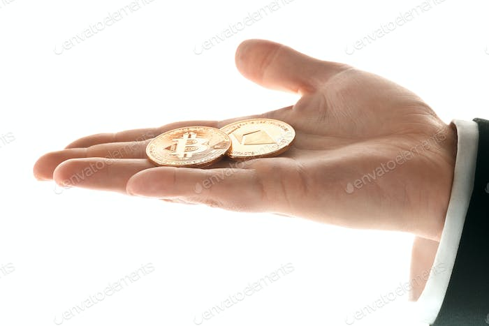 Male hand with golden bitcoin on white background