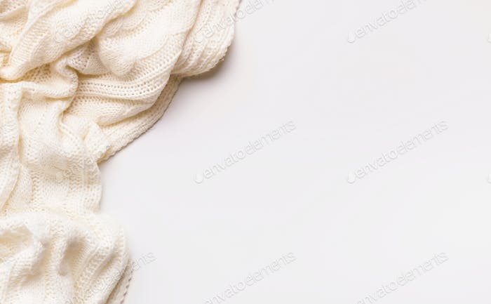 White autumn warm scarf on white background with copy space