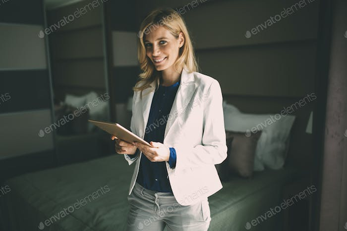 Elegant businesswoman staying in hotel