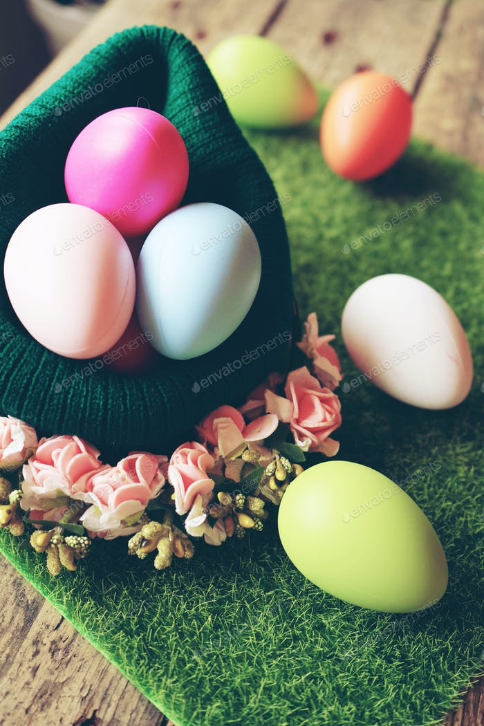 A beautiful and colorful close-up of easter eggs in a wool baske