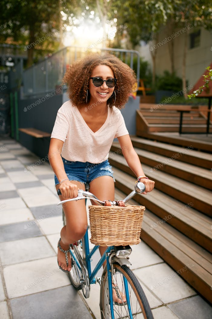 African young girl enjoying bicycle ride