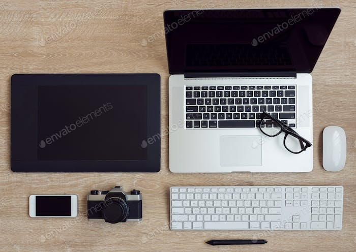 Business workplace with laptop and gadgets on wooden background