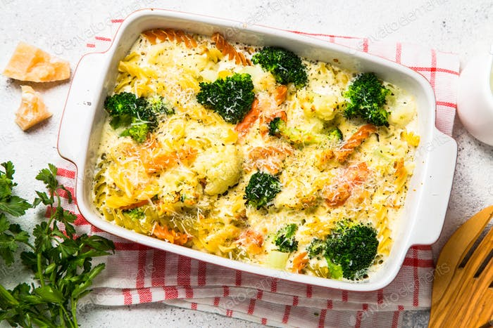 Casserole from pasta and vegetables in baking dish.