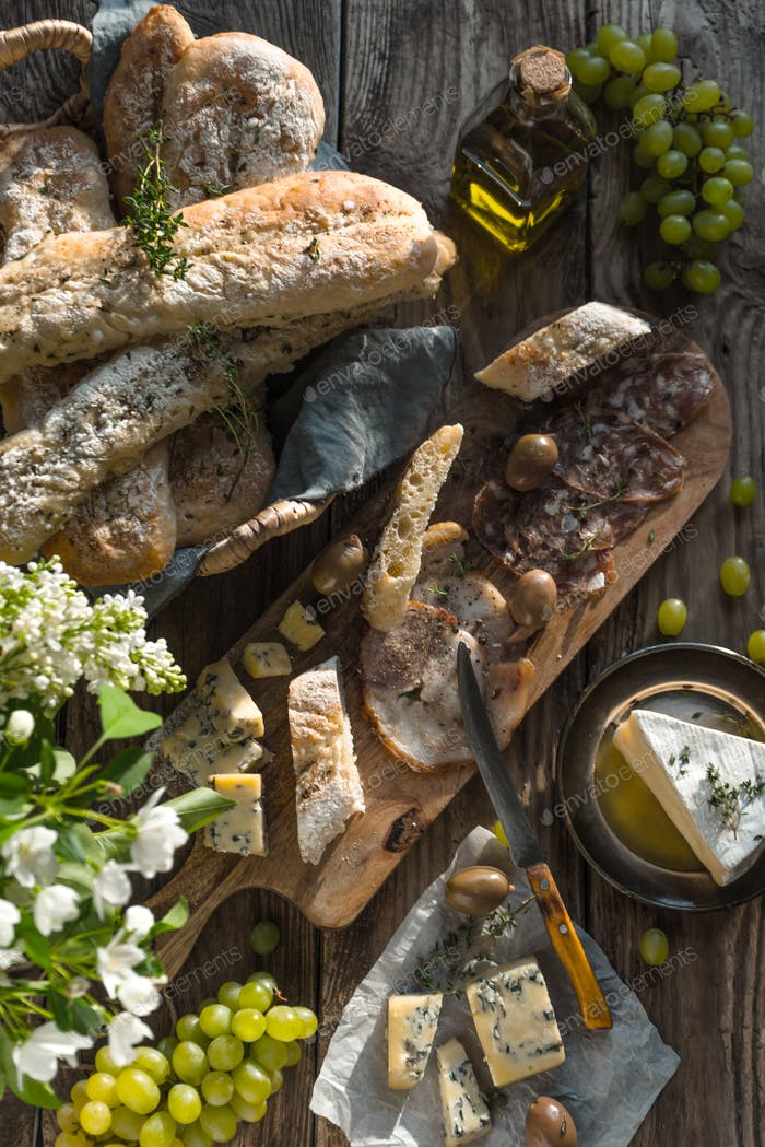 Assortment of appetizers on the wooden background top view