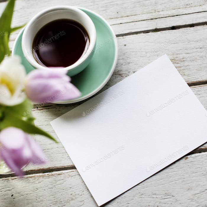 Design Space Empty Paper with Flowers and Coffee Cup Decoration