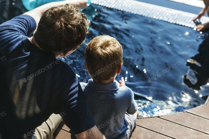 Family enjoying a swimming pool