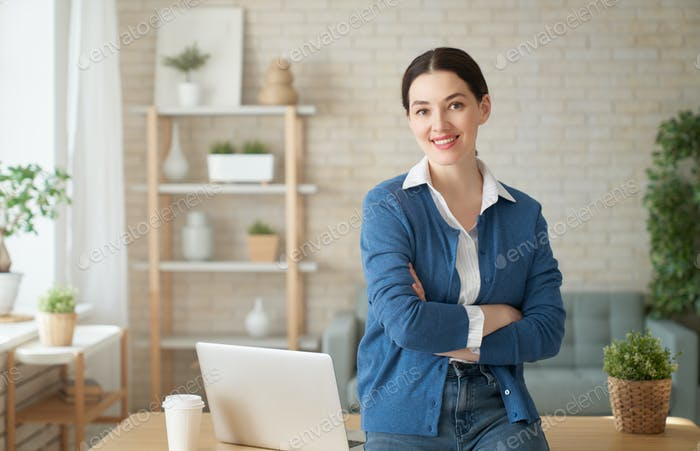 woman working on a laptop at home.
