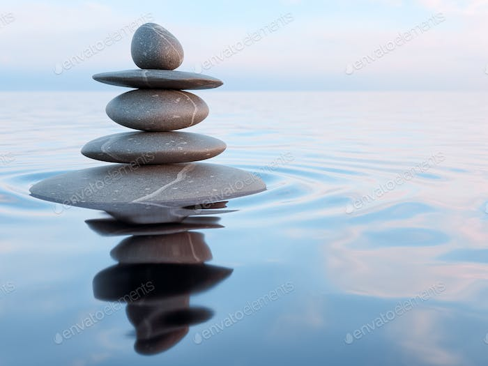 Balanced Zen stones in water