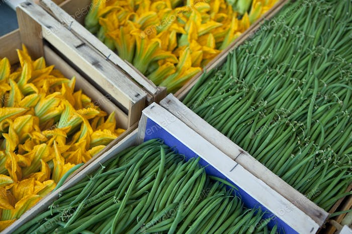 Green beans and zucchini flowers on a market stall