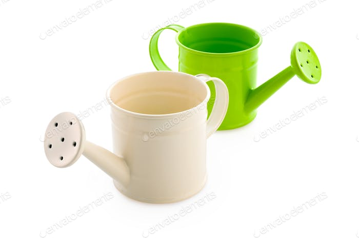 White and green watering cans