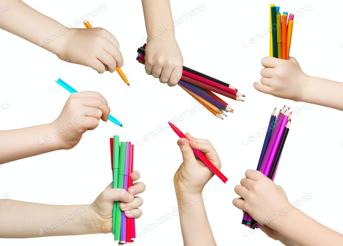 Set of child hands holding pencils and felt pens