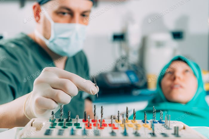 Dentist with tool for the installation dental implants
