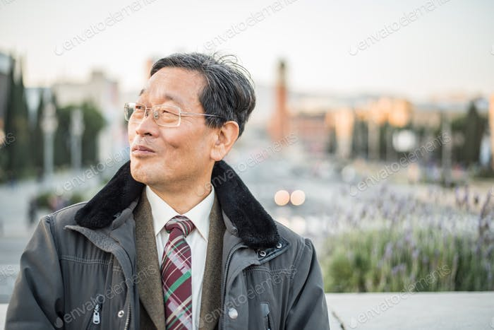 Japanese senior old man outdoors smiling and happy portrait