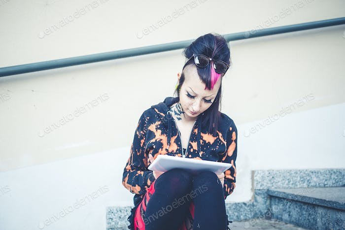 young beautiful punk dark girl using tablet