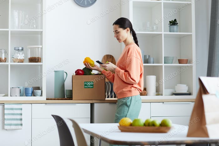 Woman checking food delivery