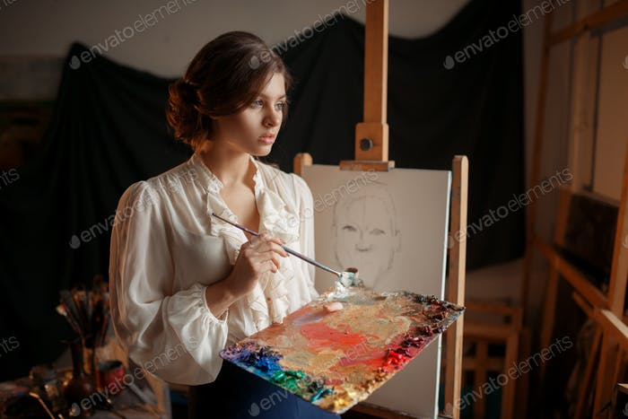 Female painter with color palette and brush