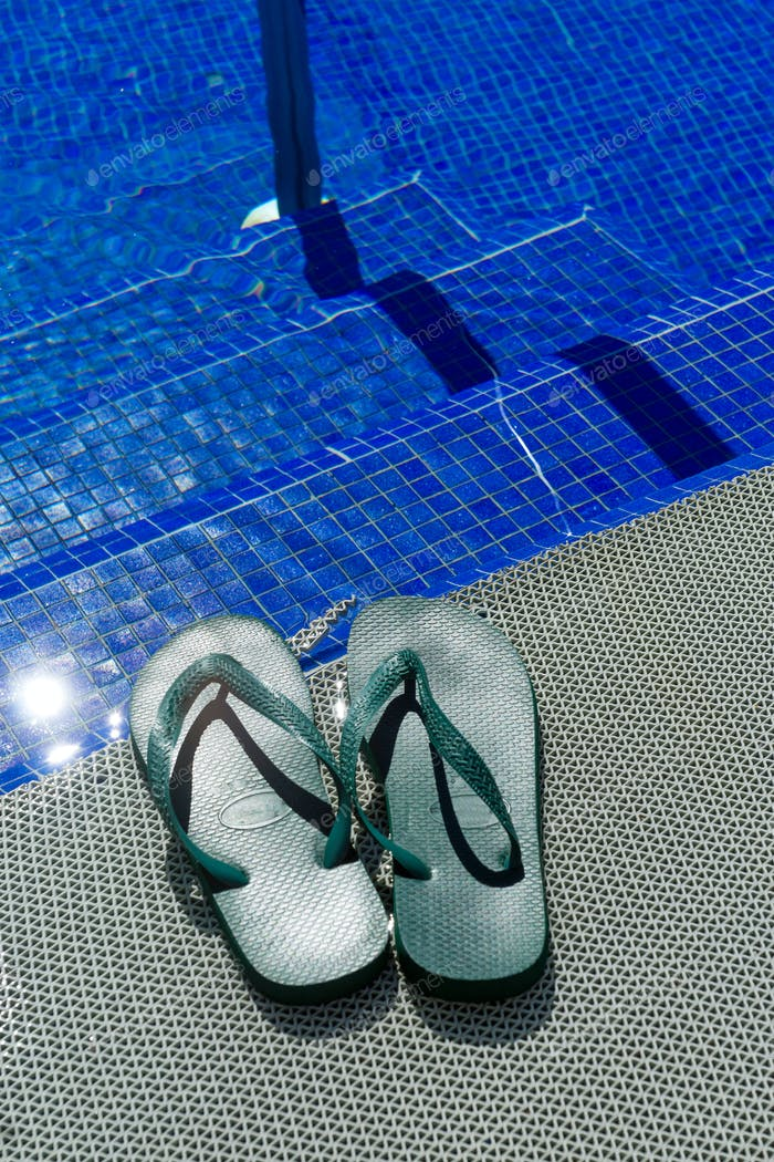 Green flip-flops at a pool