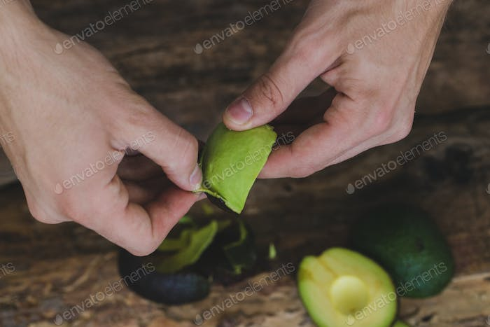 Woman cleaning avocado