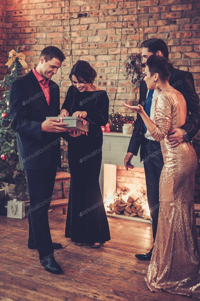 Happy beautiful couples celebrating Christmas
