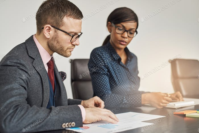 Businessman and women having a serious meeting