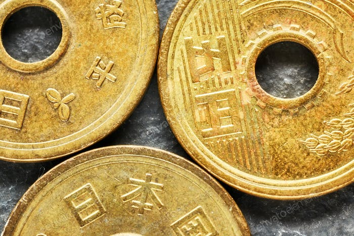 extreme close up picture of japanese yen coins photo by