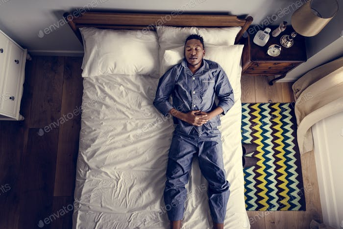Lonely man sleeping alone on the bed