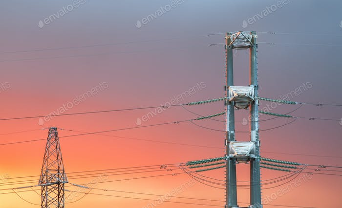 High voltage power transmission line on sunset
